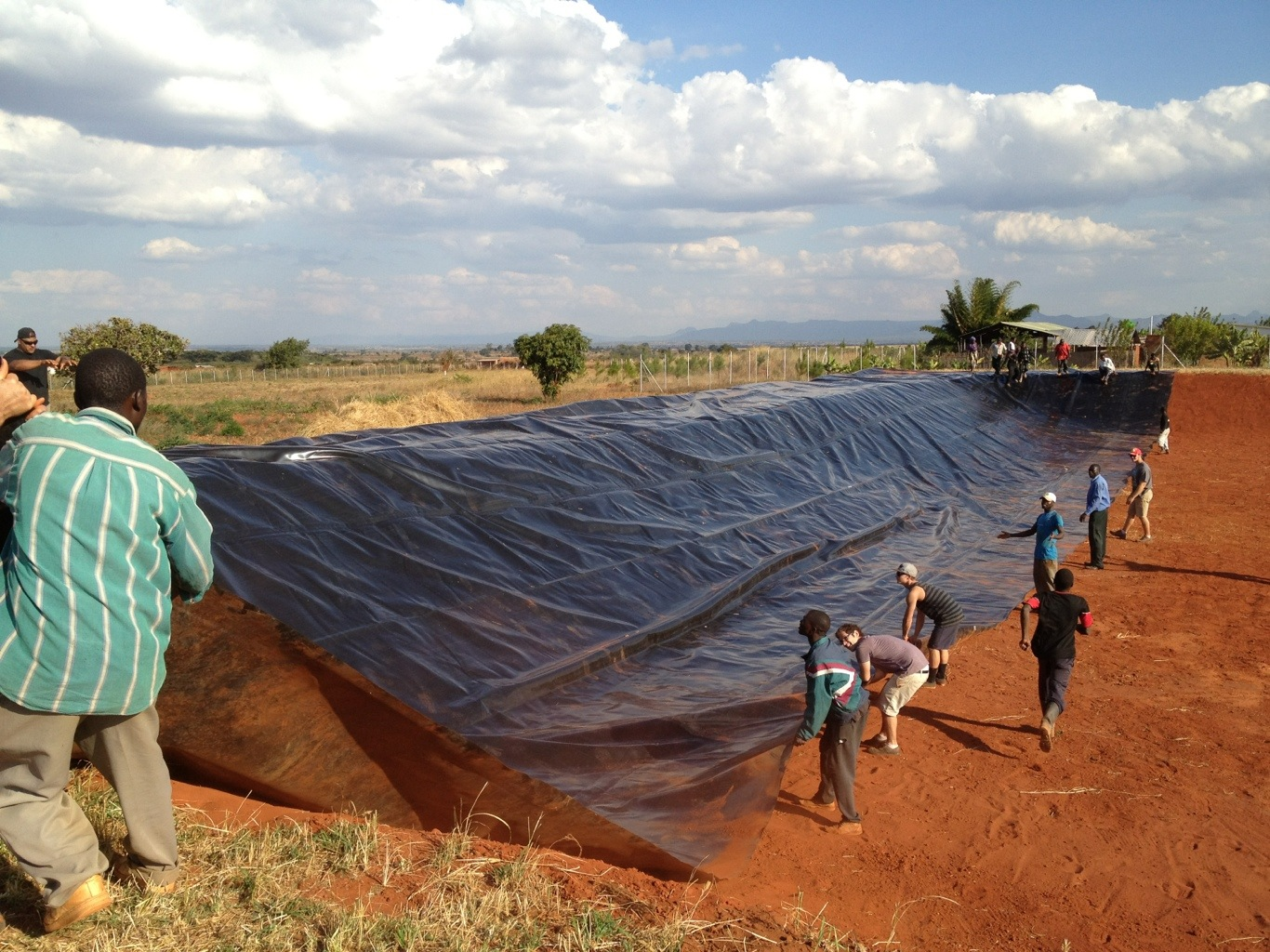 Installing Fish Pond Liner In Malawi Clean Water Climb